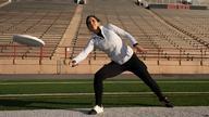 Vivian Zayas throwing a frisbee.