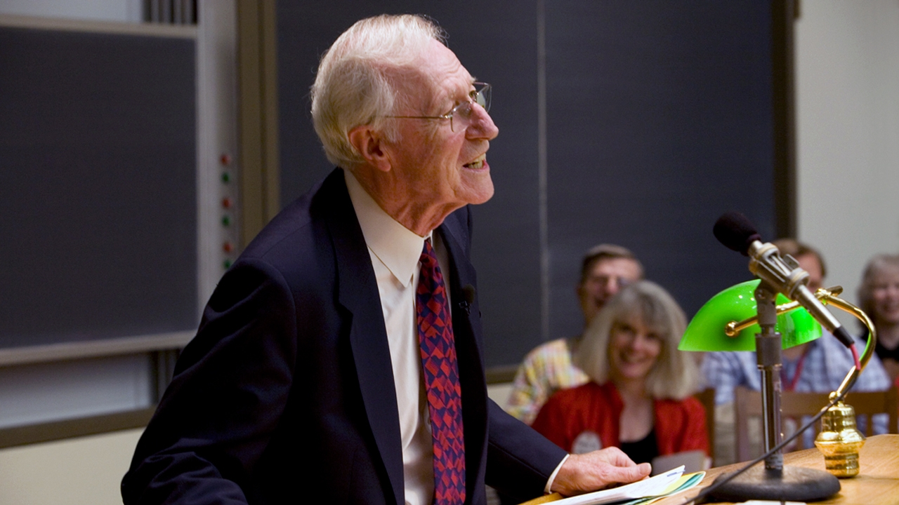 President Rhodes addresses the audience at a Reunion lecture