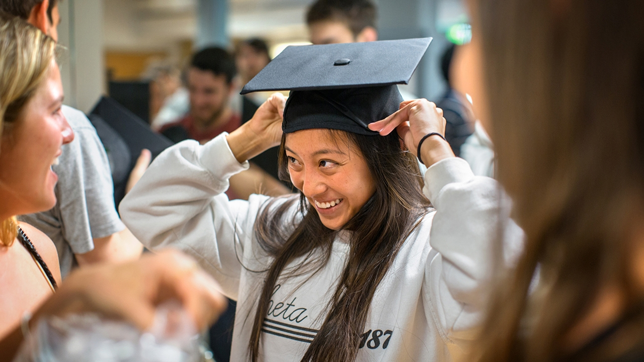 students try on caps and gowns