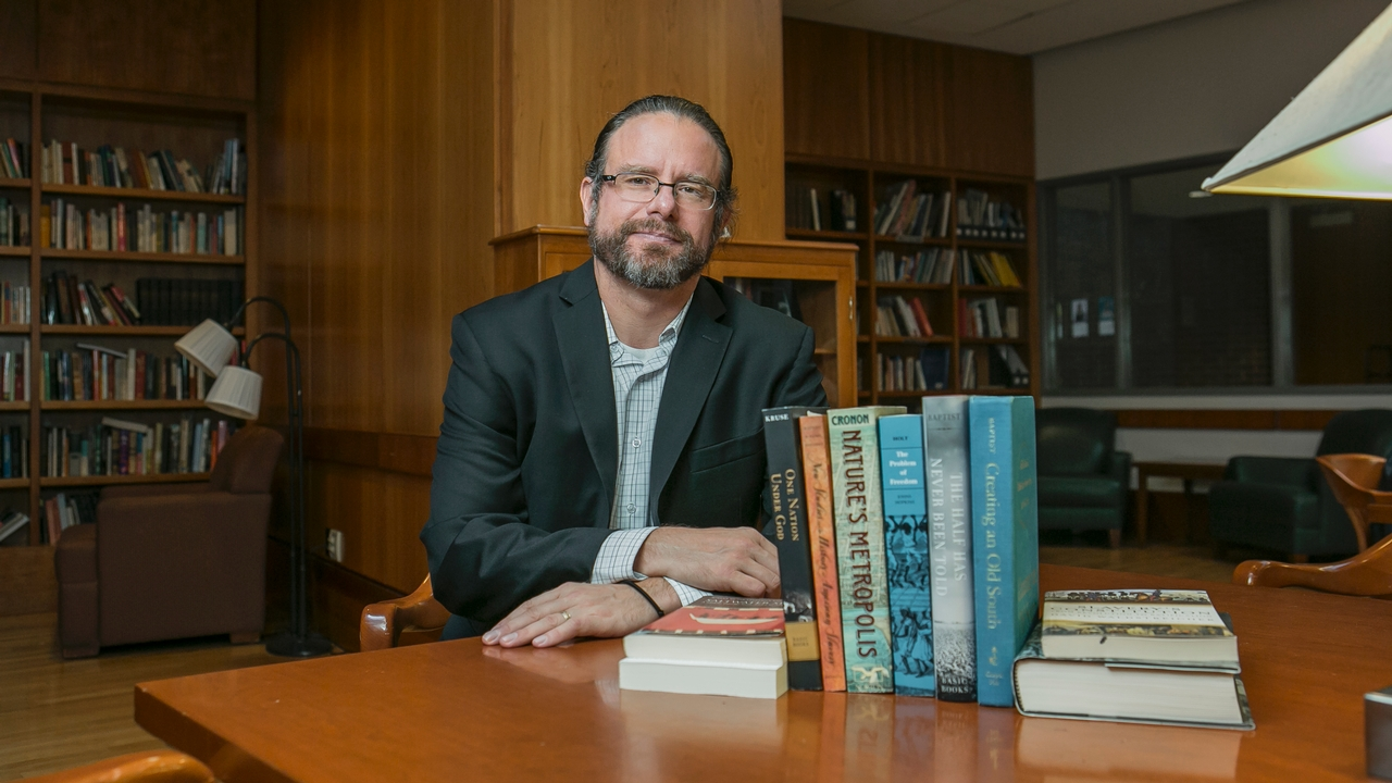 Ed Baptist in a library