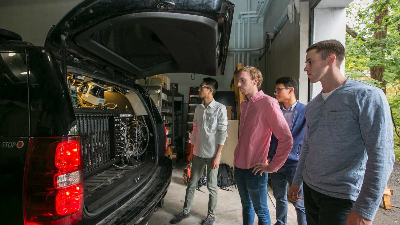 members of the Campbell lab with their intelligent car