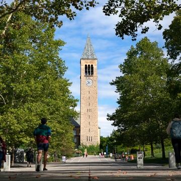 students walk on Ho Plaza at Cornell University