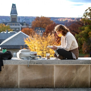 Students work on the terrace outside the Physical Science Building on a warm fall afternoon