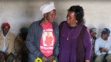 Anne Gighangi with a Kenyan woman attending training