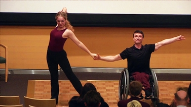 Nicole Agaronnik and Rik Daniels perform on stage