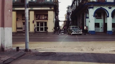 classic car turns a corner in Havana, Cuba