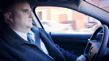 Police detective Brad Connors in his car
