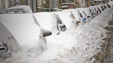 Cars buried in snow on College Avenue.