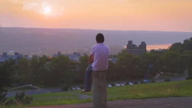 young man looks out at the horizon