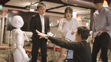 SoftBank employee demonstrates Pepper to Cornell students