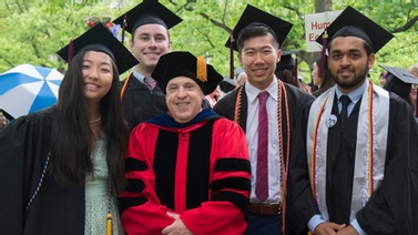 Human Ecology graduates with Dean Mathios