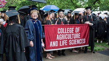 Dean Kathryn Boor with CALS graduates