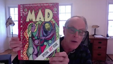 panelist holds up an issue of MAD Magazine