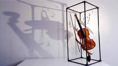 violin casts a shadow on the wall