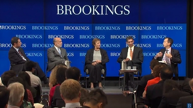 panelists on stage at Brookings