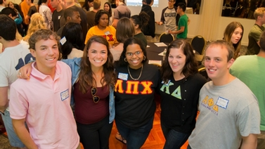 Fraternity and sorority members wearing Greek letter shirts