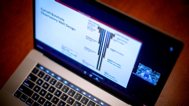 virtual forum viewed on a laptop
