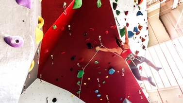 Women hangs from new Lindseth climbing wall