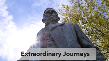 view of the Ezra Cornell statue with the words, 'Extraordinary Journeys'