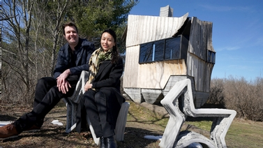 Leslie Lok and Sasa Zivkovic in front of the cabin