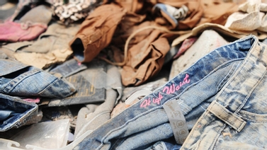 Clothes lie in the rubble at Rana Plaza