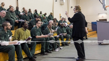 Esta Bigler speaks to inmates