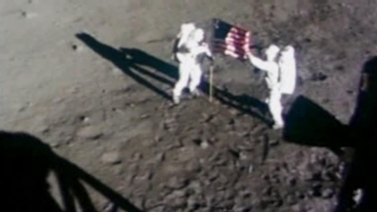 Apollo 11 astronauts unfurl the American flag on the moon
