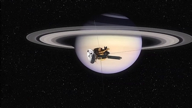 satellite in orbit around Saturn