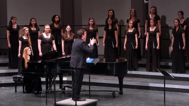 chorus performs on stage