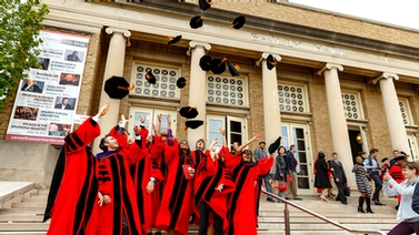 Law School graduates throw their caps in the air