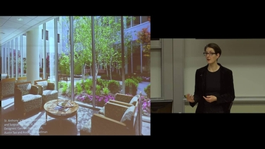 Naomi Sachs presents a photo of a landscaped courtyard at a medical center