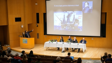 panelists look on as Scott Shapiro gives his presentation