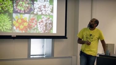 Anurag Agrawal looks at the projector screen showing different flowers