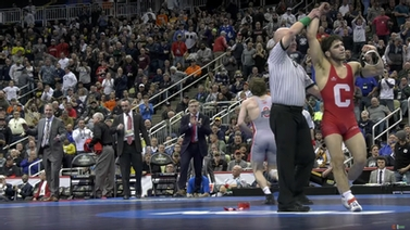 ref holds up winner Yianni Diakomihalis' hand