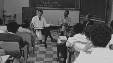 old photo of a doctor leading a class discussion