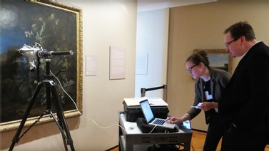 Louisa Smieska conducts x-ray fluorescence analysis of a painting