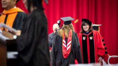 President Pollack congratulates a graduate