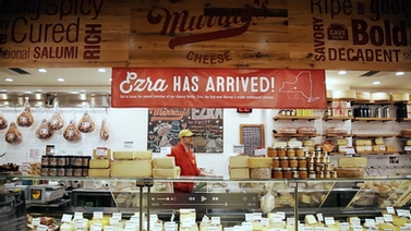 'Ezra has arrived' banner hangs inside Murray's cheese shop