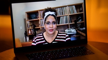 laptop shows Zoom video call with Ijeoma Oluo