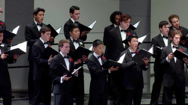 Cornell Glee Club on stage at Bailey Hall