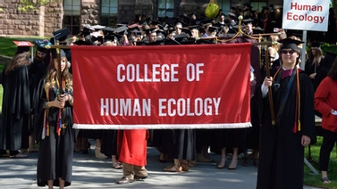 Human Ecology graduates walk in the procession