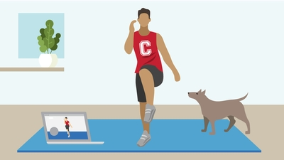 Man exercising at home with dog and laptop on either side.