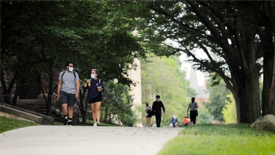 Students walk on the Arts Quad