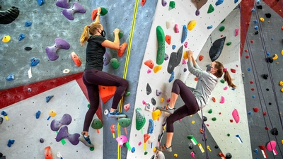 Students rock climb at Lindseth Climbing Center at Cornell University
