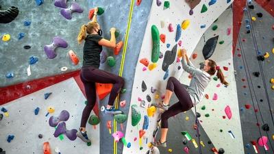 Students rock climb at Lindseth Climbing Center at Cornell University