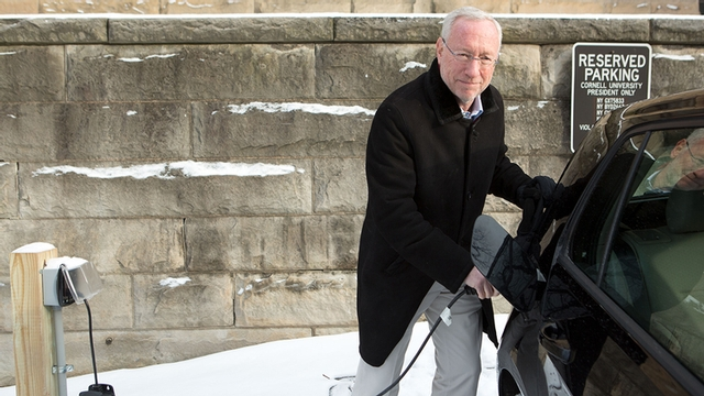 Provost Kotlikoff plugs in his electric car outside Day Hall