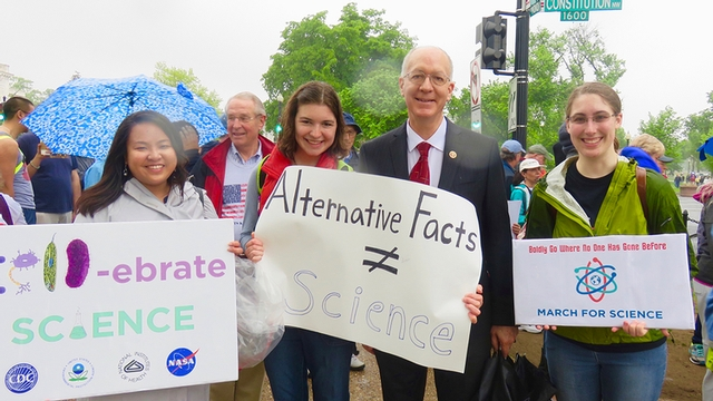 Heley Ong, left, Francine Barchett, U.S. Rep. Bill Foster, D-Illinois, and Lauren Gilliland pose at Constitution Avenue, along the March for Science route, April 22.