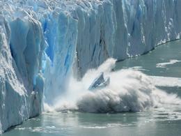 Photo of glacier calving into ocean