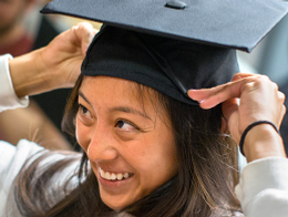 woman smiling trying on mortar board