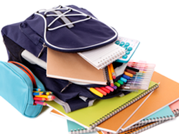 photo of backpack with lots of colorful supplies spilling out